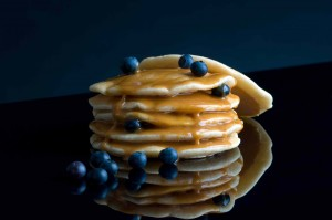 Pour on piles of pancakes